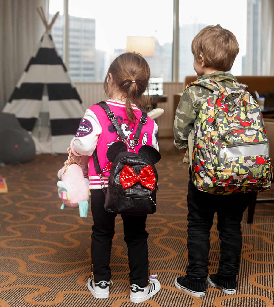 Leaving the Swissotel with a Minnie Mouse Backpack.