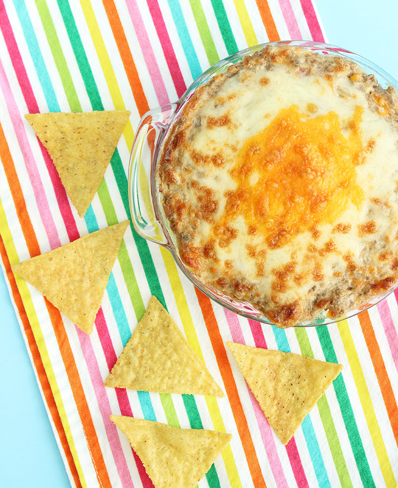 Cheesy bacon cheeseburger dip with extra cheese for an easy summer BBQ appetizer.