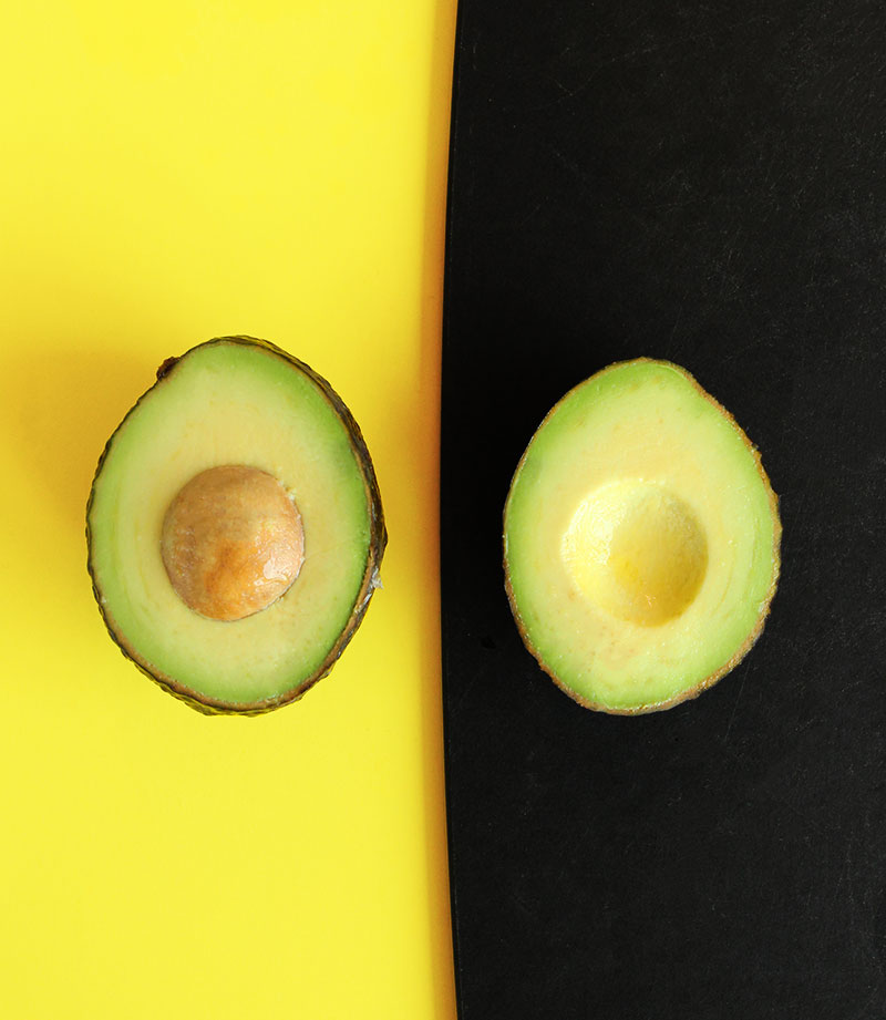 How to slice an avocado in half.