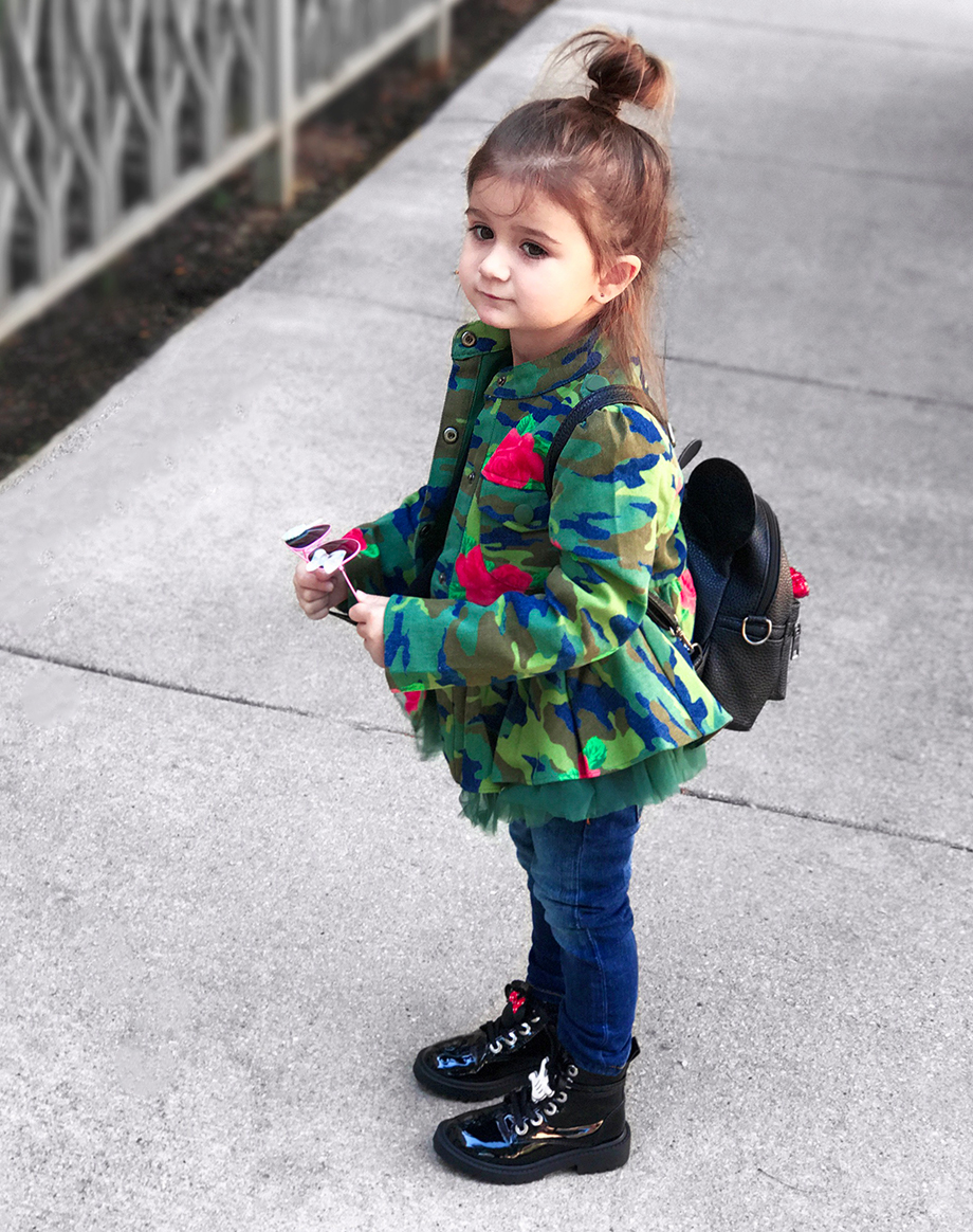 The best fall jackets for toddlers featuring a camo print jacket.