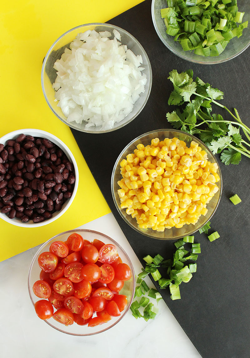Vegetables and toppings for turkey taco bowls.