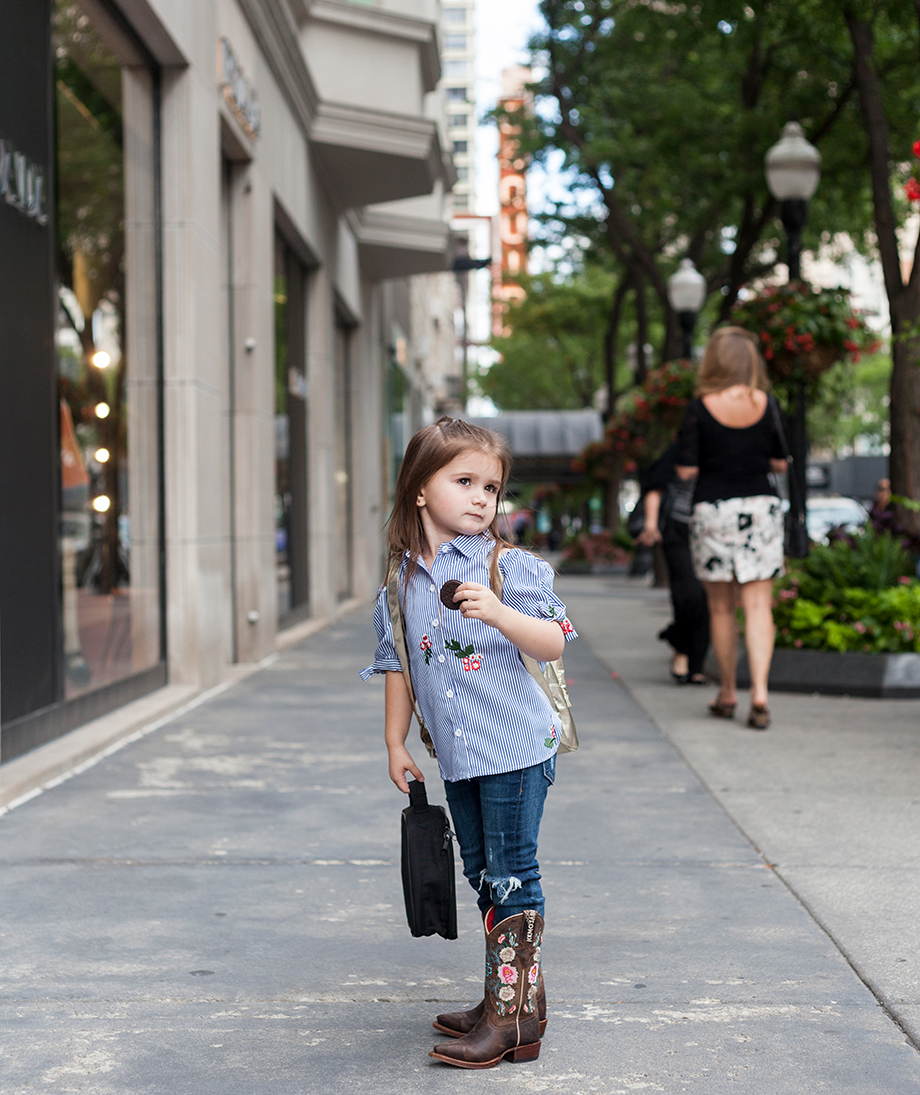 A little girl wearing a striped shirt.