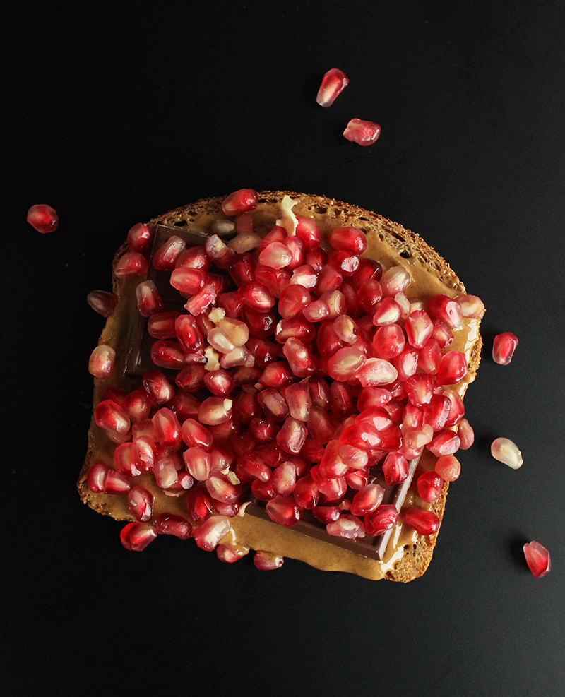 Building chocolate pomegranate sandwiches with bacon and peanut butter.