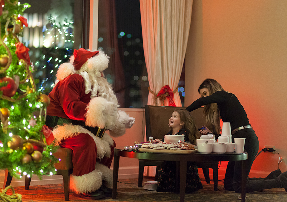 A little girl gets her hair done by BloHaute for a holiday event.