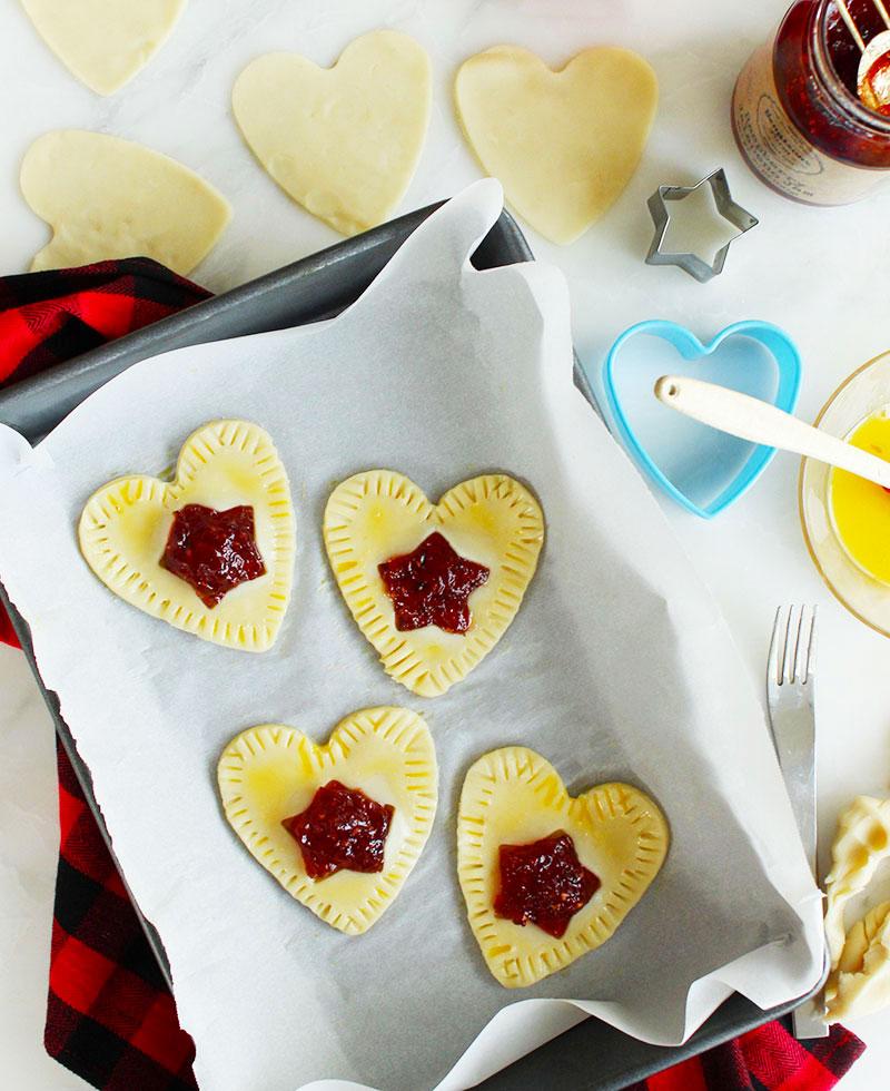 Baking pop hearts with children.