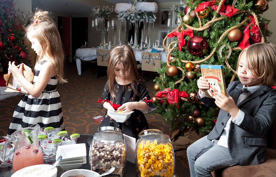 Children eating popcorn in the Santa Suite.