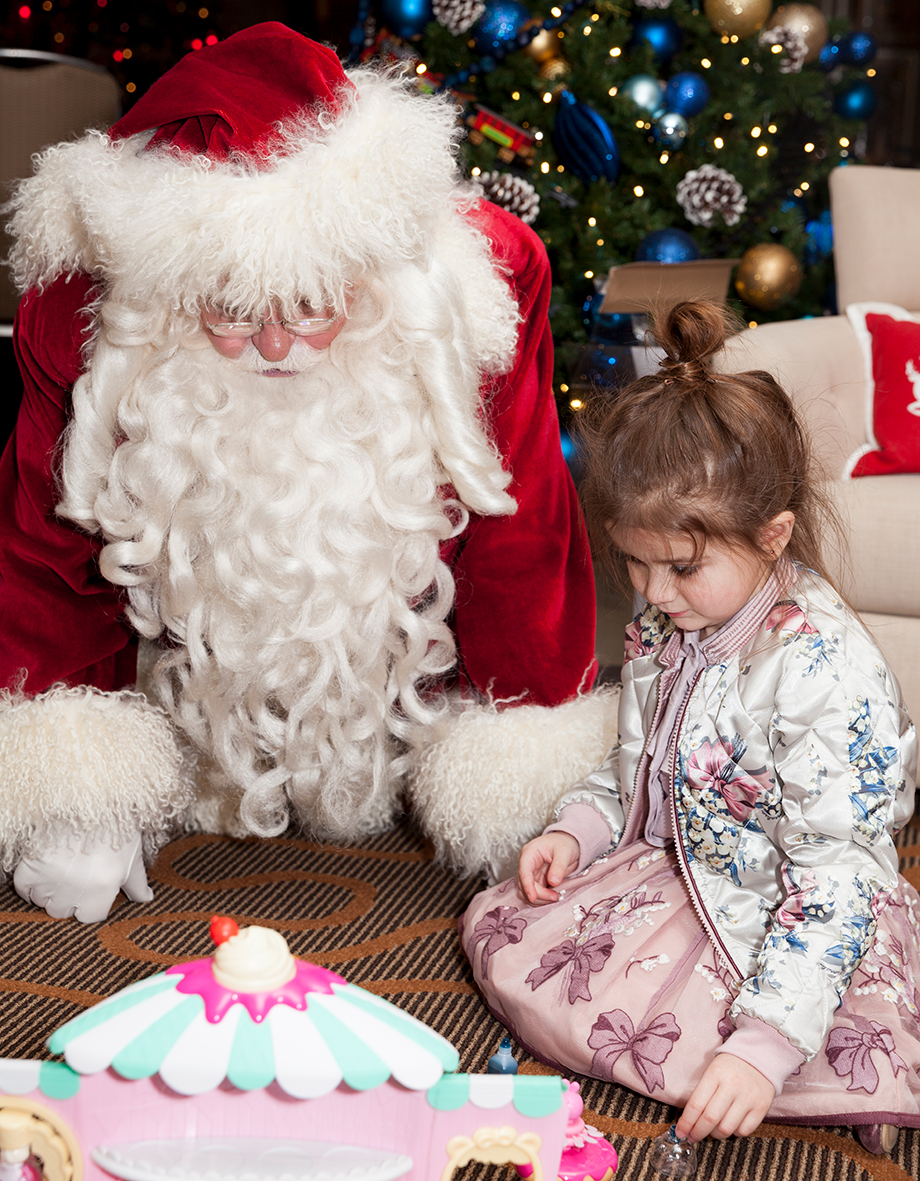 Opening presents with Santa at the Swissotel.