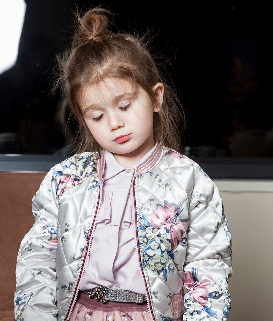 A little girl wearing a floral Monnalisa jacket at the Swissotel