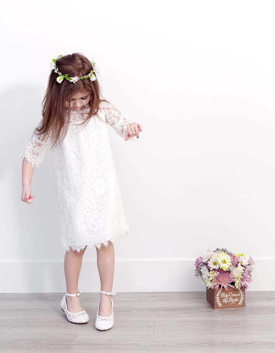 A lace white dress from David's Bridal and a flower crown.