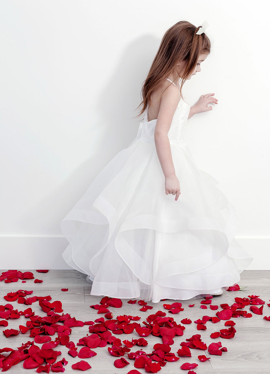 A stunning white flower girl dress from David's Bridal.