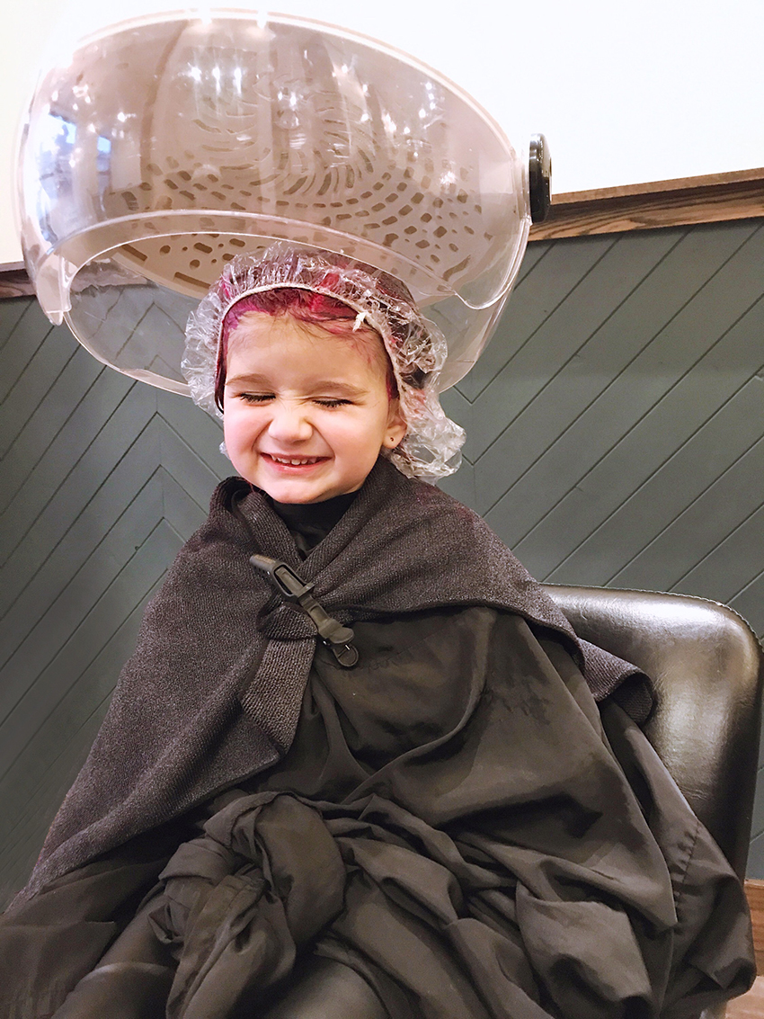 Zelda of Glitter and Bubbles sits under a hairdryer at Base Salon.