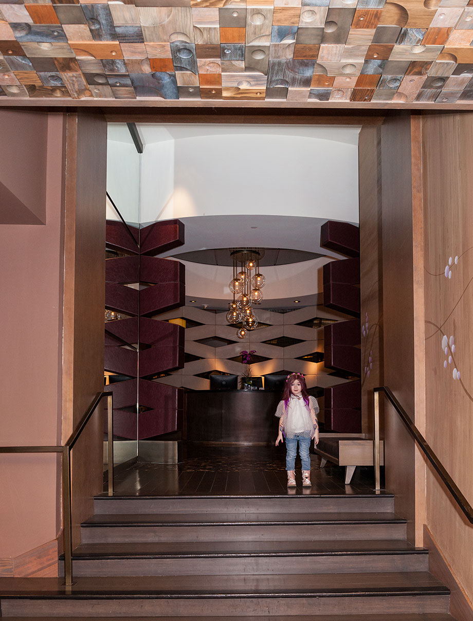 A toddler walks to the front desk of Nobu Hotel in Las Vegas.
