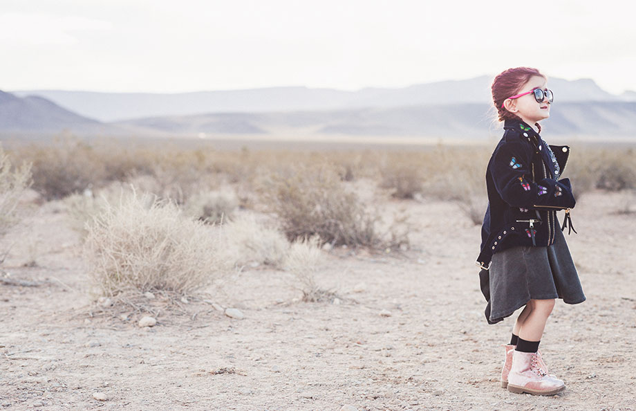 Zelda of Glitter and Bubbles stands in the Las Vegas desert.