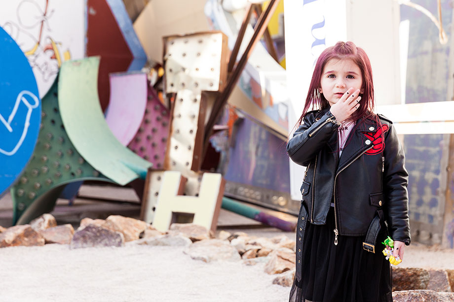 Zelda of Glitter and Bubbles wears a leather Lola + the Boys jacket at the Neon Museum.