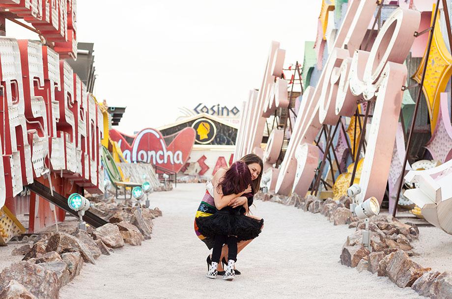 Zelda and Corri McFadden of Glitter and Bubbles hug at the Neon Museum in Las Vegas.
