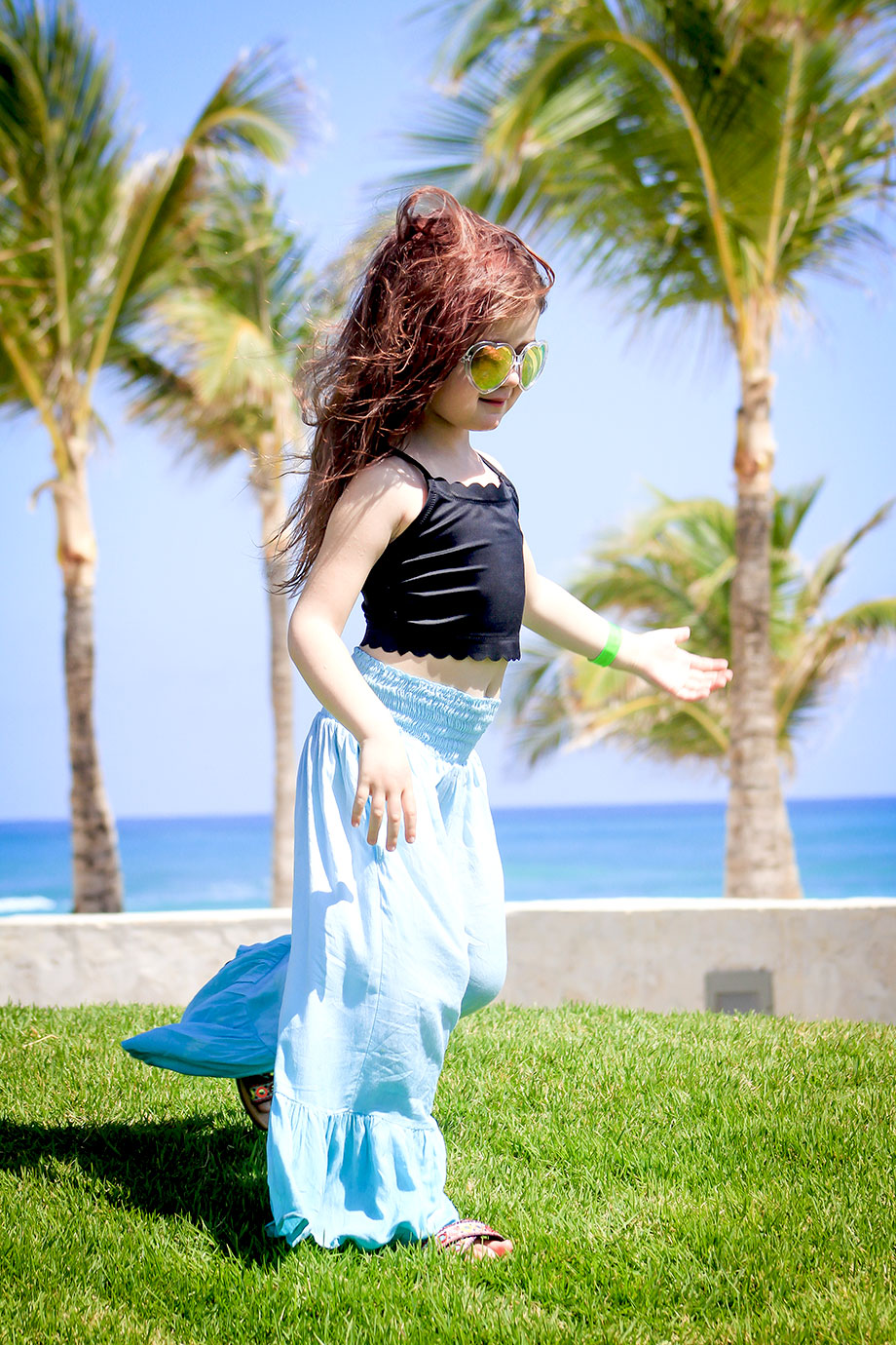 Zelda of Glitter and Bubbles stands near the water in Punta Cana.