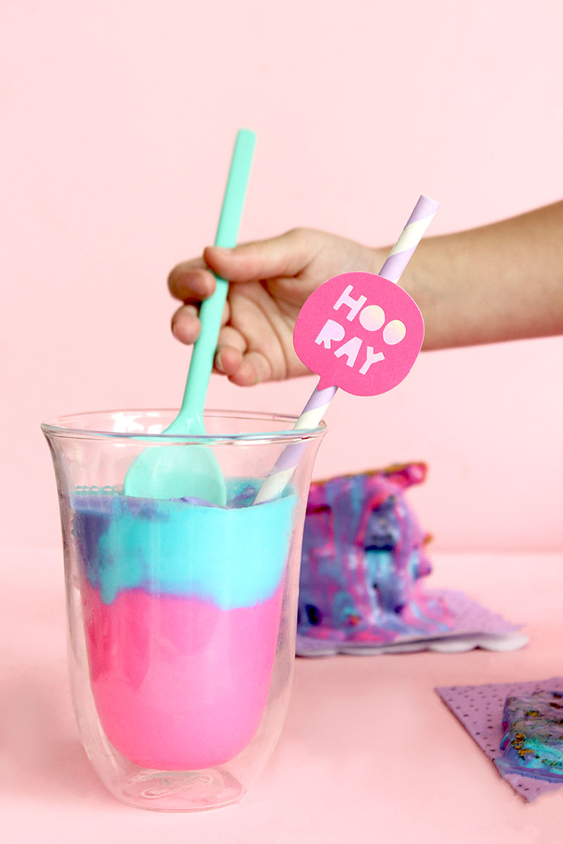Zelda of Glitter and Bubbles mixes together blue, purple and pink ice cream.
