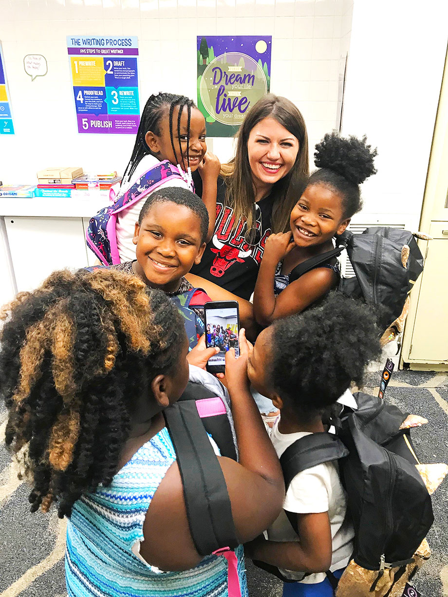 Corri McFadden brings school supplies to the Englewood Youth Center.