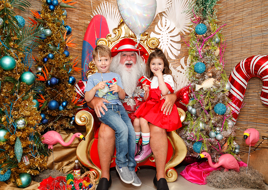 Zelda of Glitter and Bubbles sits on Santa's lap at the Swissotel.