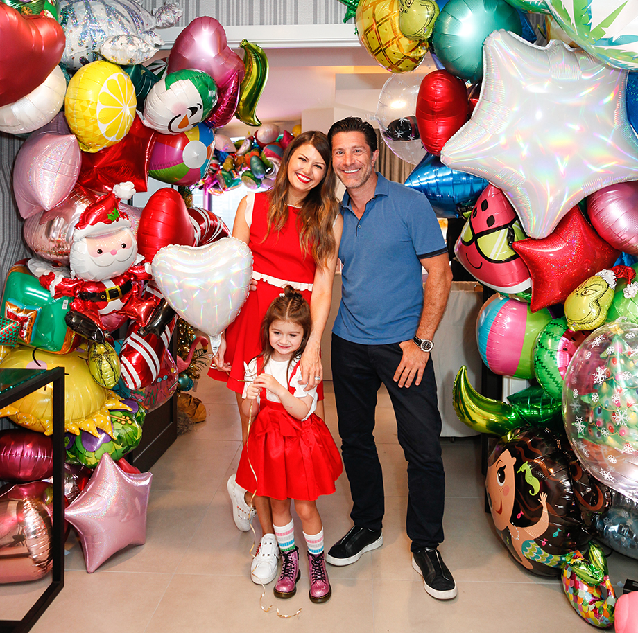 Corri McFadden and family throw their daughter a birthday party at the Swissotel with a Christmas in July theme.