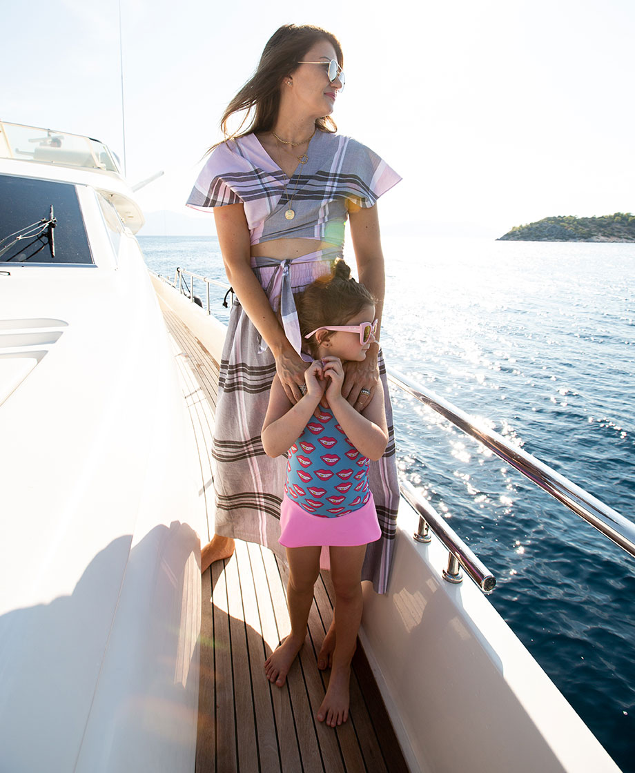 Corri McFadden stands with her daughter Zelda on a boat in Greece and reflects on time passed.