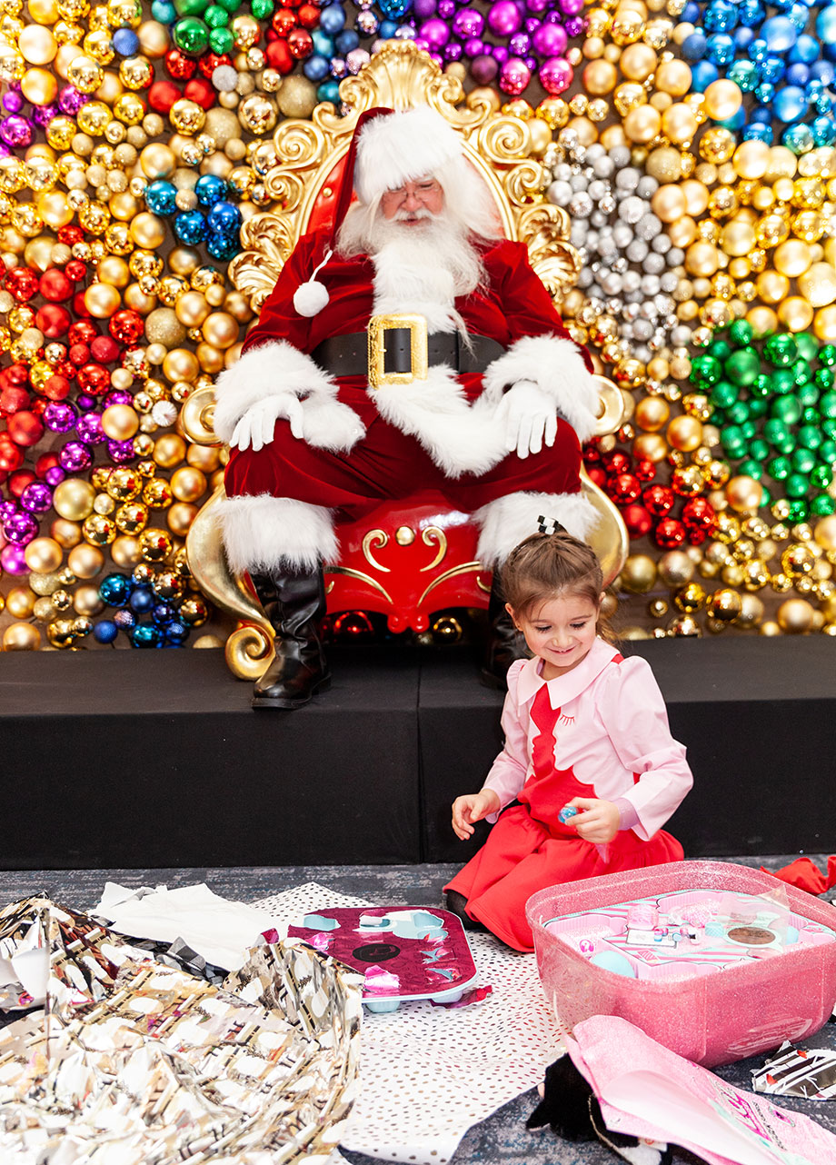 Zelda opens presents from Santa at the Swissotel Santa Suite.