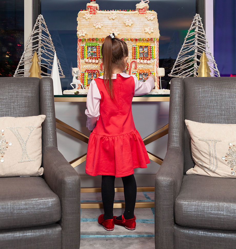 Zelda looks at the Gingerbread House in the Swissotel Santa Suite.