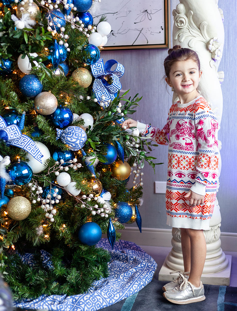 Zelda stands by the Christmas tree in the Santa Suite at the Swissotel.