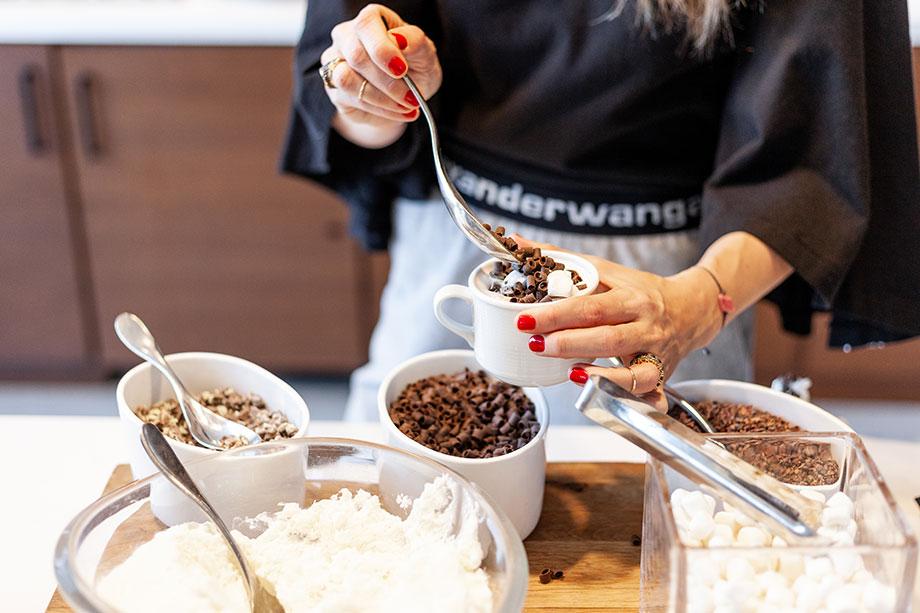 Corri McFadden builds a hot chocolate.