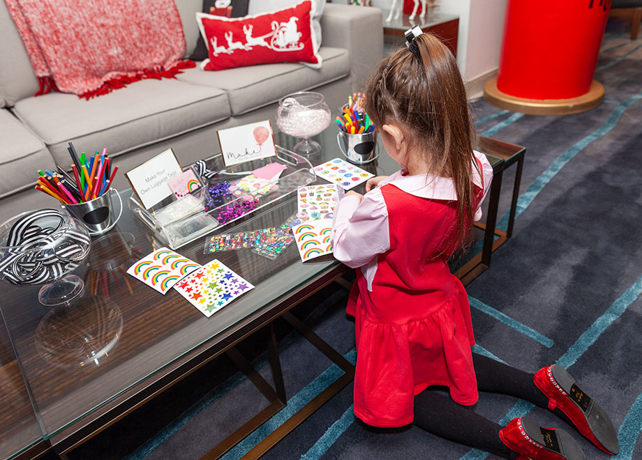 Zelda makes crafts in the Santa Suite at the Swissotel.