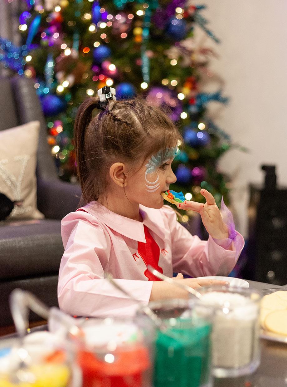 Zelda enjoys a Christmas Cookie in the Swissotel Santa Suite.