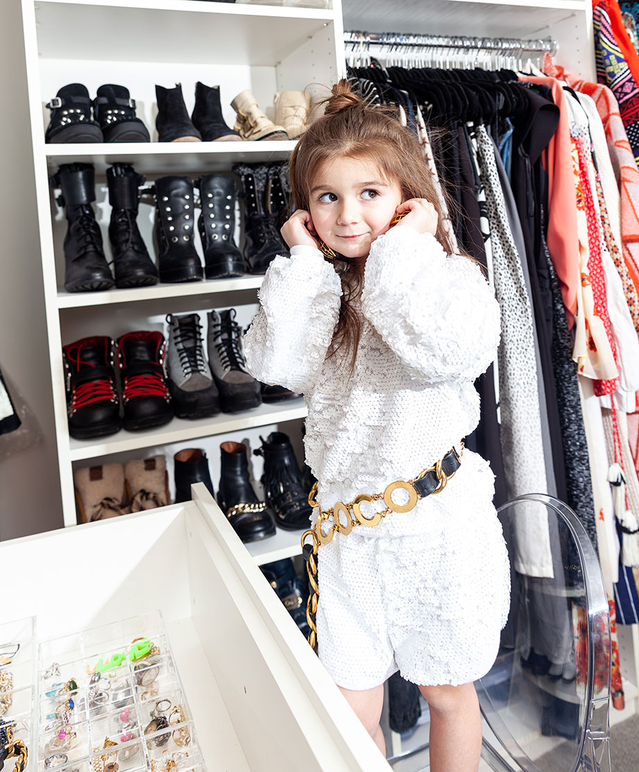 Zelda of Glitter and Bubbles stands in her mom's closet.