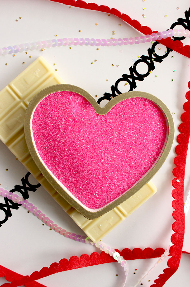 Heart shaped pink sprinkles with white baking chocolate.