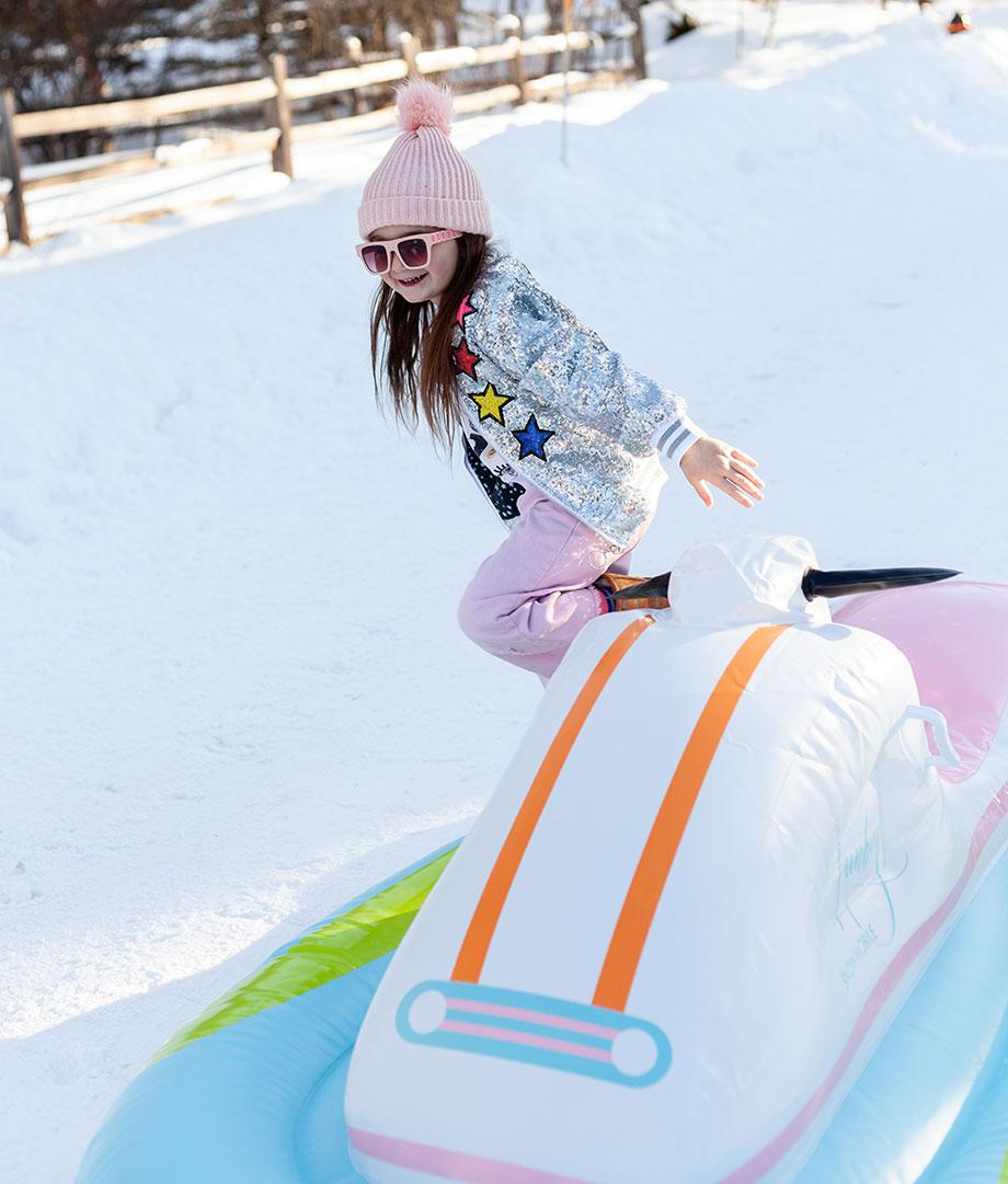 Zelda plays on her funboy snow tube.