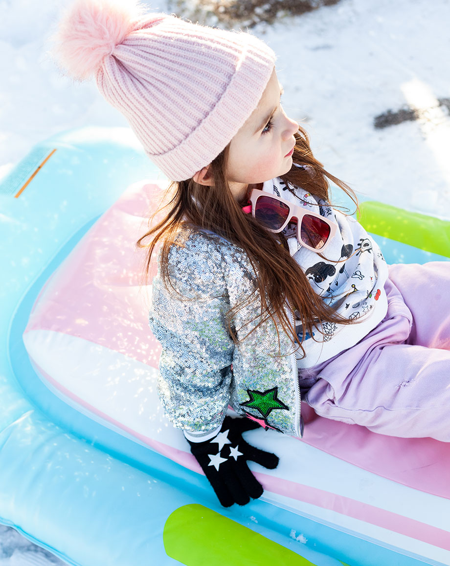 Zelda of Glitter and Bubbles plays outside in the snow in Aspen.