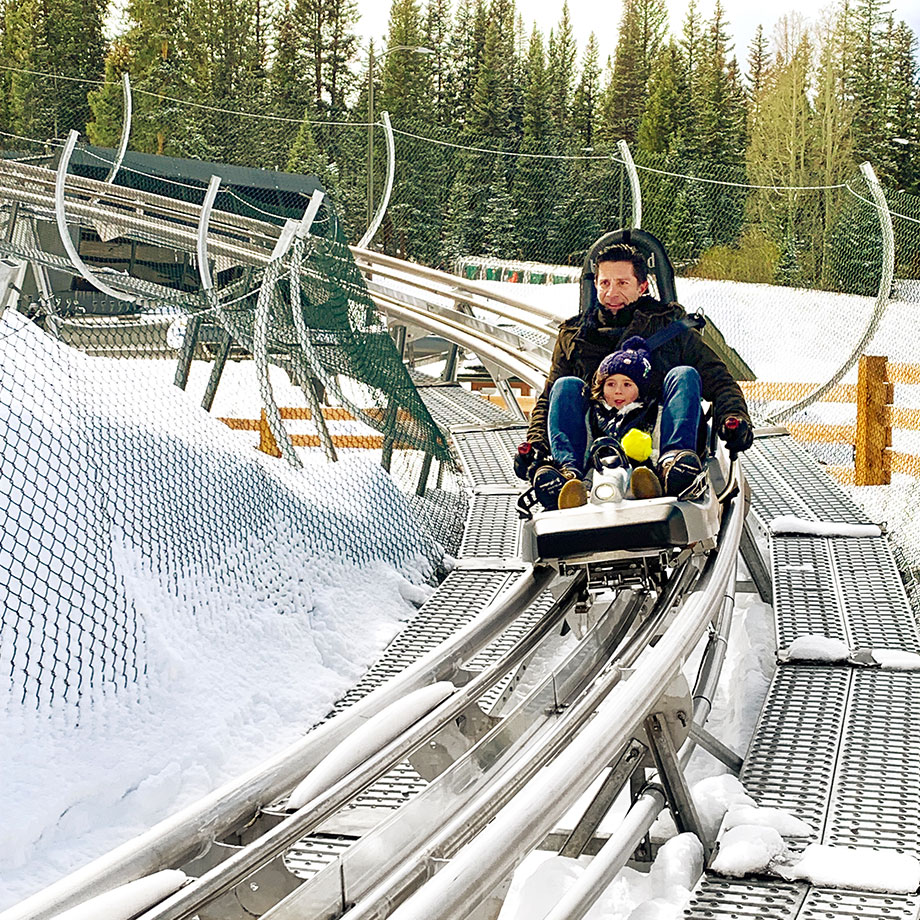 Glitter and Bubbles hops on a roller coaster in Aspen.