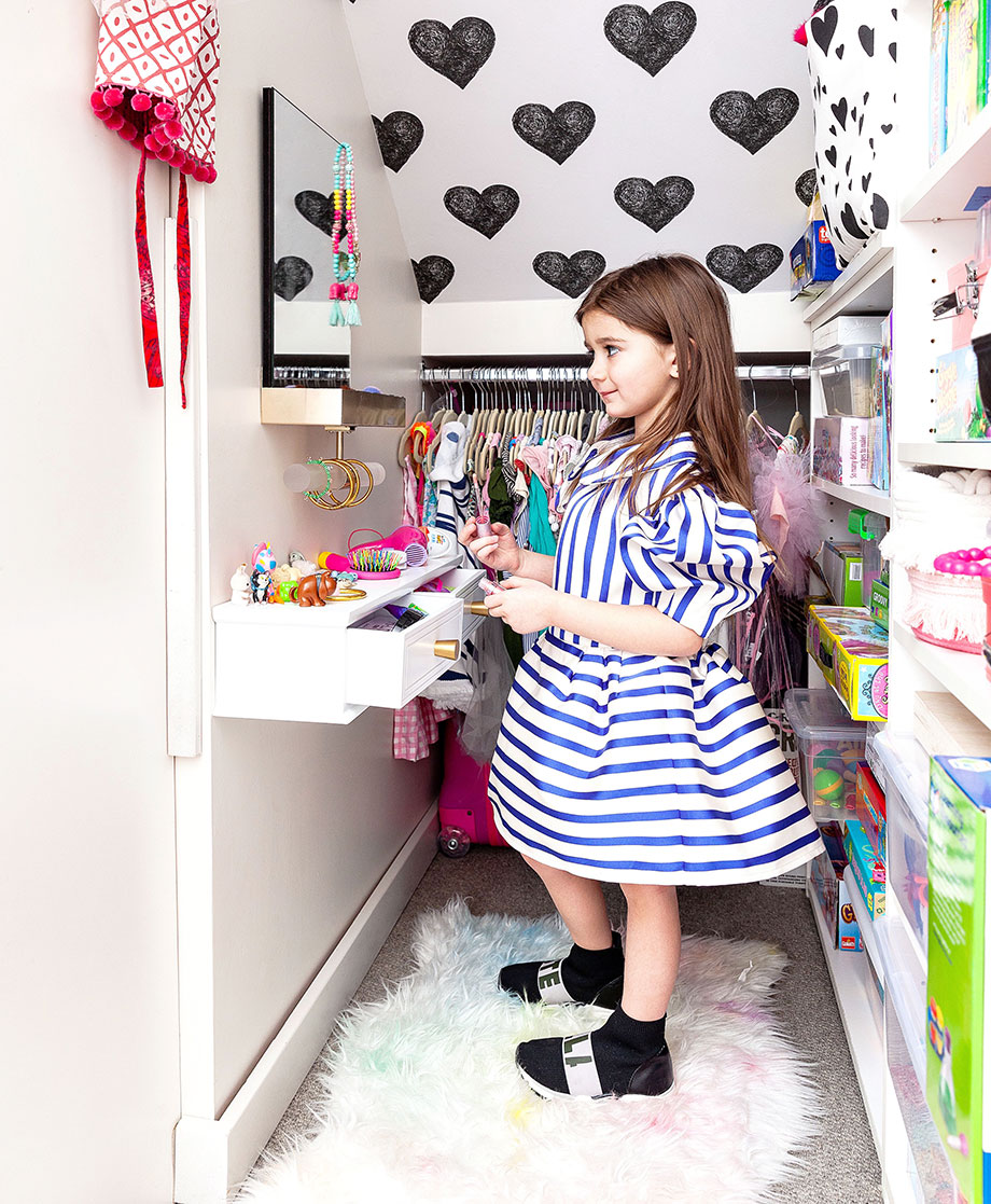 Zelda of Glitter and Bubbles plays in her dress up room.