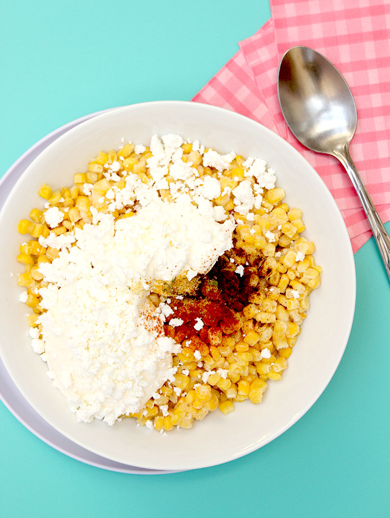 Glitter and Bubbles shows you what to mix in a bowl to make delicious Mexican Street Corn Casserole.