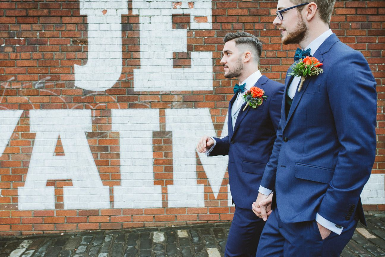 In action same-sex wedding portrait near Drygate Brewery