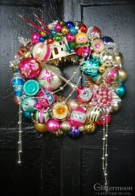 "PINK PIXIE Pinks and other delights make for a bright wreath. Featuring lots of fabulous ornaments for your Christmas pleasure. 17"" $265 *SOLD*"
