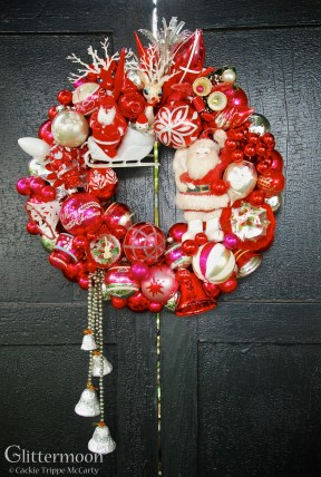 "It's Red Wreath - If you love red then this is for you! With wonderful vintage Santas, a very old set of bells dripping from the lower left, and other vintage goodies. 26"" tall - including tail - 15"" across - approx. 16"" diameter $245 *SOLD*"