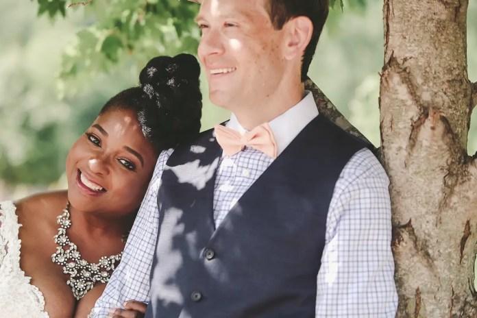 bride leaning on groom shoulder