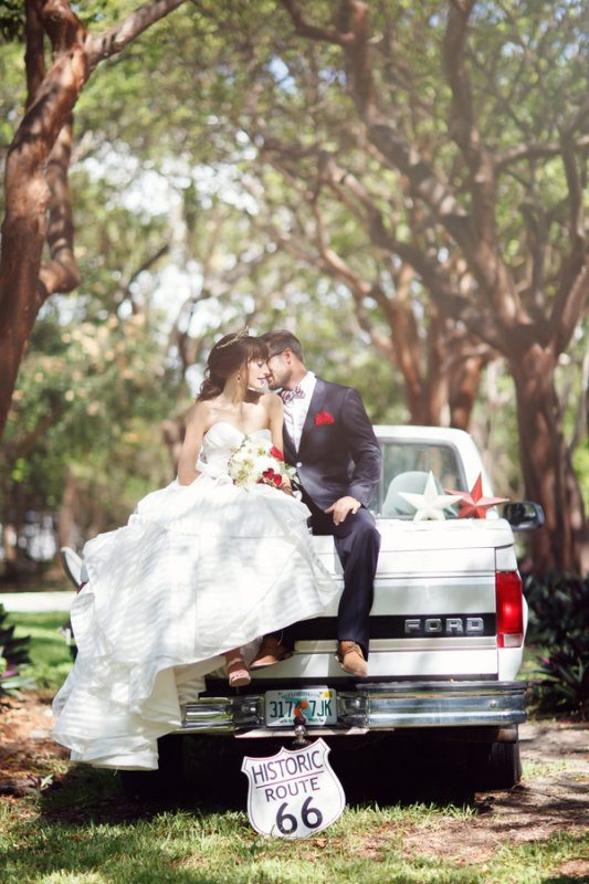 bride and groom on back of pickup truck