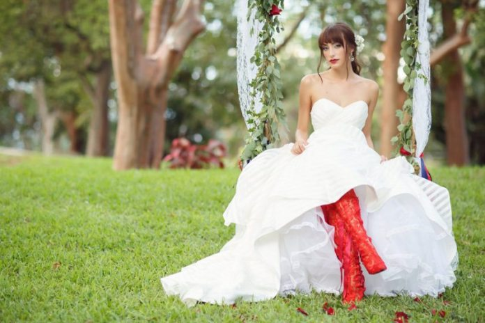 bride on swing with boots