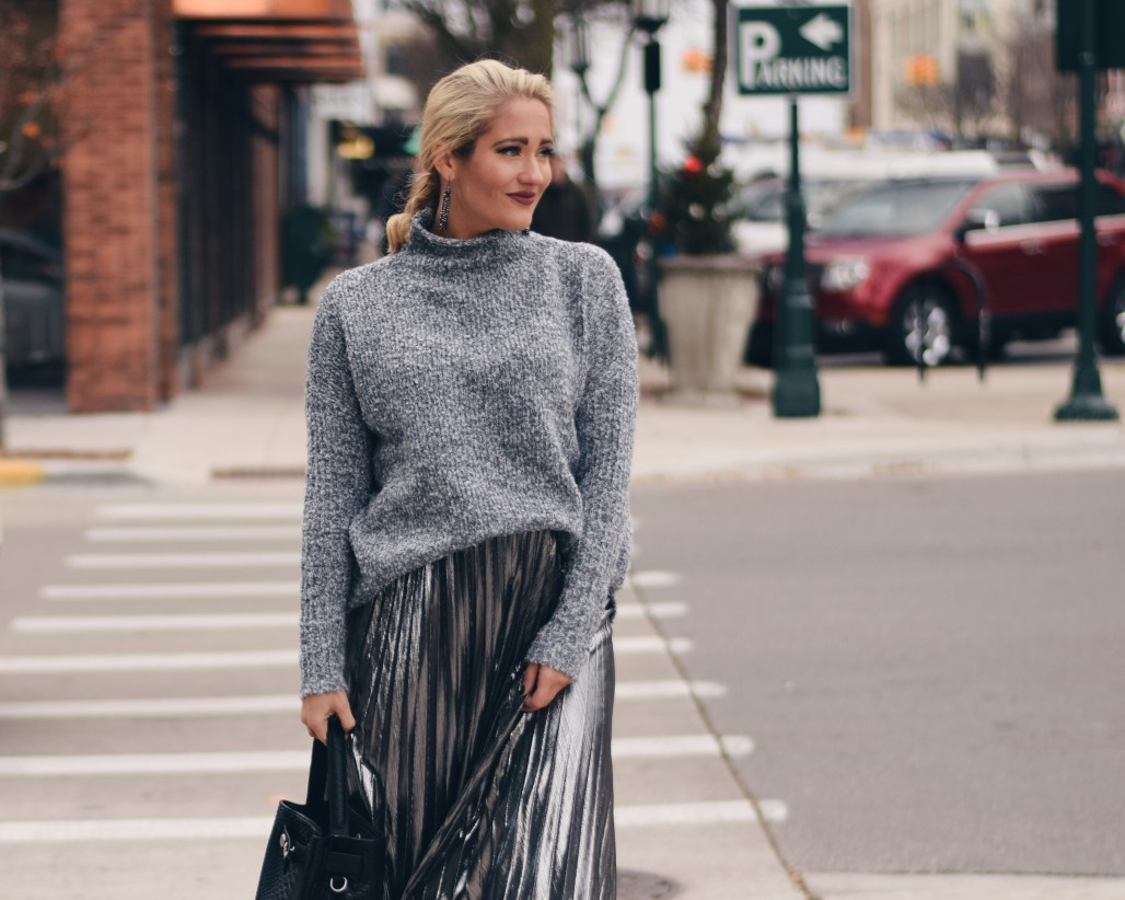 Grey marled mock neck sweater with metallic pleated midi skirt
