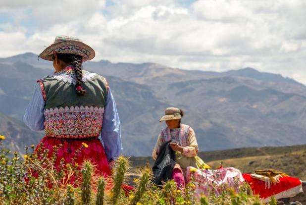 Women in traditional costume near Colca Canyon, Peru