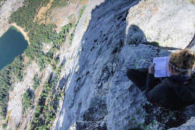 reading book on mountain adventure