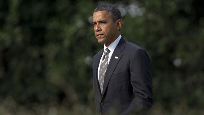 Sept. 26, 2012: President Obama walks from the Oval Office of the White House to Marine One, en route to Ohio. (AP)