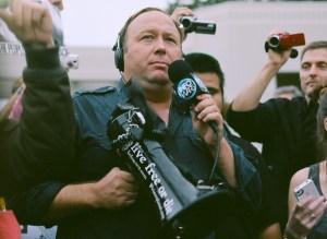 Alex Jones carrying a bullhorn