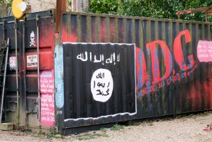 A Daesh flag painted on a fence